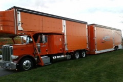 Driver Chris Carter...Taking pride in his ride!!! Ready to load another load of cars going across the country.